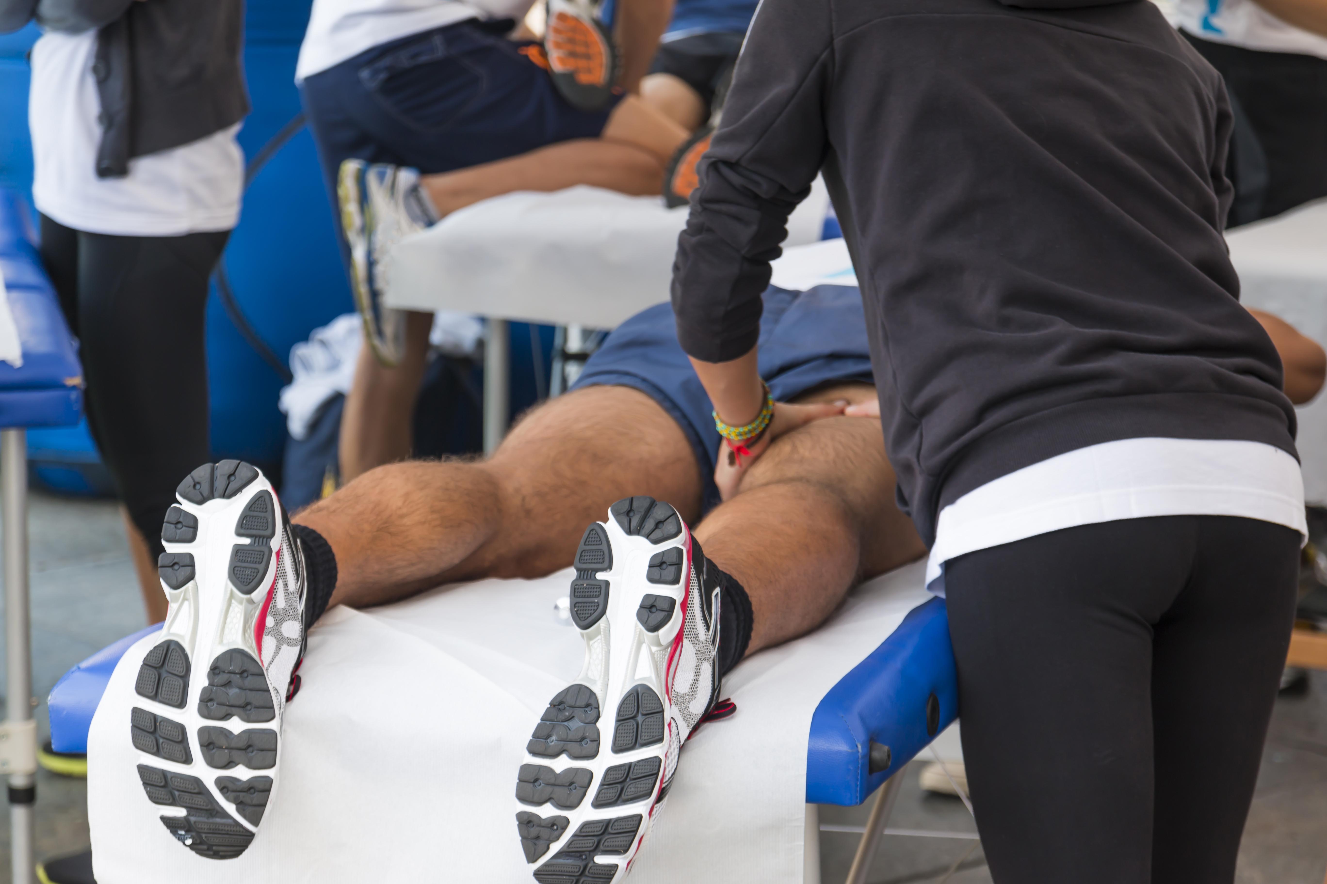 athletes relaxation massage before sport event, marathon muscles massage